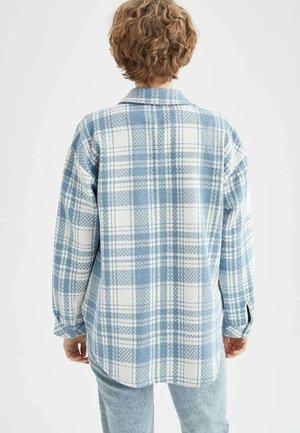 OVERSIZED - Button-down blouse - blue