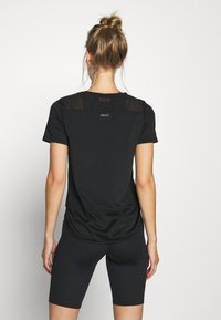 Hunkemöller - PERFORMANCE - Sports shirt - black - 2