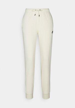 Teplákové kalhoty - coconut milk