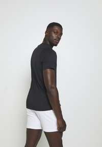 Nike Performance - GRAPHIC - Print T-shirt - black/volt/neo turq - 2