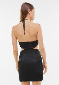 Bershka - SHORT SATIN CUT OUT HALTER DRESS - Cocktail dress / Party dress - black - 2