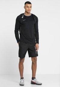 Nike Performance - DRY ACADEMY SHORT - Sports shorts - black/white - 1