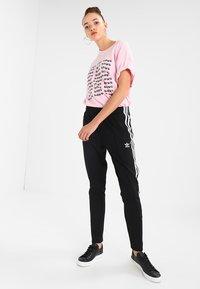 adidas Originals - Trainingsbroek - black - 1