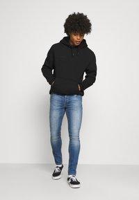 Jack & Jones - JJILIAM JJORIGINAL - Slim fit jeans - blue denim - 1