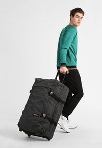 Eastpak - TRANVERZ L CORE COLORS - Wheeled suitcase - black denim - 1