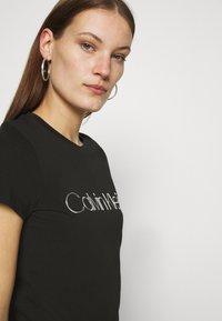 Calvin Klein - SLIM FIT METALLIC LOGO TEE - Print T-shirt - black - 3