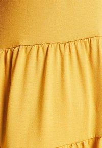 New Look Curves - TIER PEPLUM - Long sleeved top - dark yellow - 6