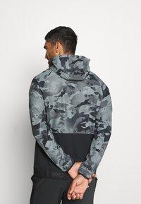 Nike Performance - Outdoor jacket - black/grey fog - 2