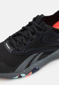 Reebok - HIIT TR - Sports shoes - core black/true grey/orange fluo - 5
