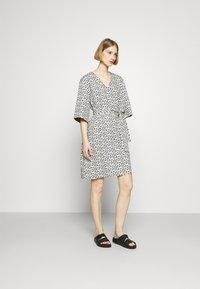Marimekko - IHMETYS PIKKUINEN UNIKKO DRESS - Day dress - black/off-white - 1