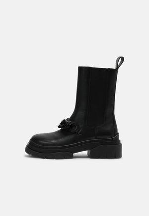 STORM CHAIN - Platform boots - black