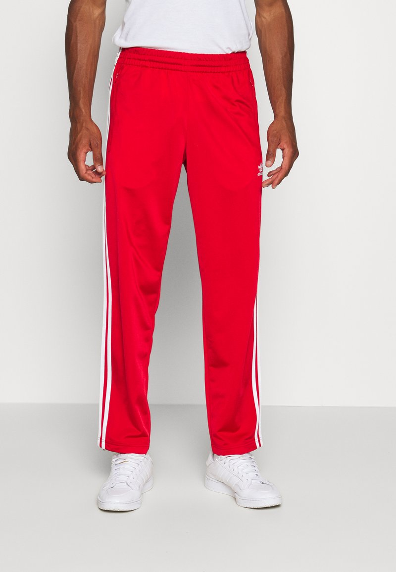 adidas Originals - Tracksuit bottoms - scarle/white