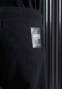 Superdry - Tracksuit bottoms - black - 3