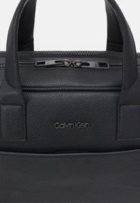 Calvin Klein - LAPTOP BAG - Taška na laptop - black - 4