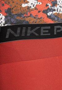 Nike Performance - FLEX REP SHORT - Sports shorts - dune red - 6