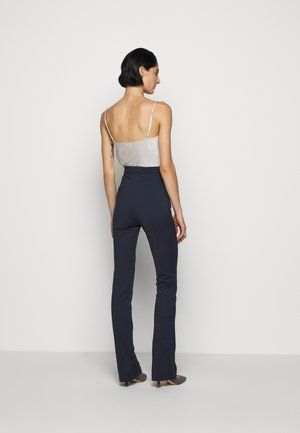 FLARED TROUSERS - Pantaloni - navy