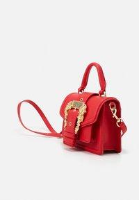 Versace Jeans Couture - MINI TOP HANDLE - Handbag - rosso - 4