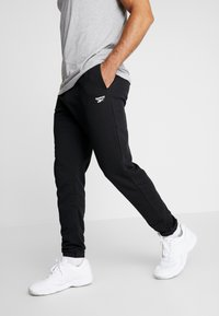 Reebok - CUFFED PANT - Pantalones deportivos - black - 0