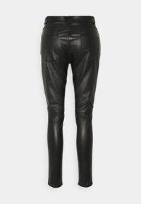 sandro - PAMEL - Leather trousers - noir - 1
