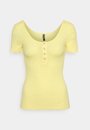 PCKITTE - Print T-shirt - pale banana