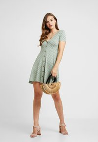 Envii - ENMUSIC DRESS - Jersey dress - light green/black - 2