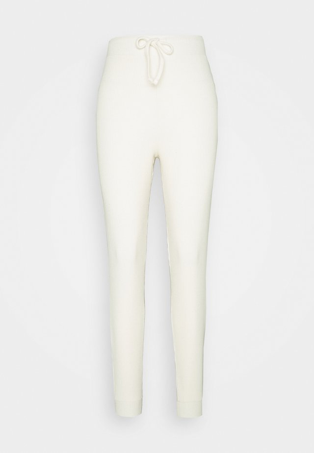 BRUSHED JOGGER - Leggings - Trousers - cream