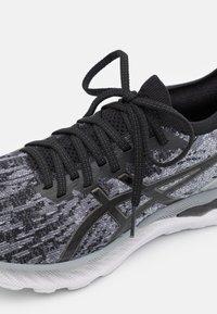 ASICS - GEL NIMBUS 23 KNIT - Neutral running shoes - sheet rock/black - 5