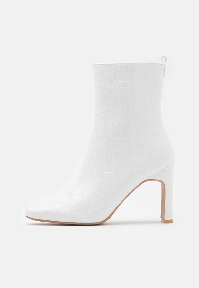 HURSTON - Classic ankle boots - white