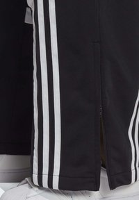adidas Originals - DANIËLLE CATHARI JOGGERS - Pantalon de survêtement - black - 6