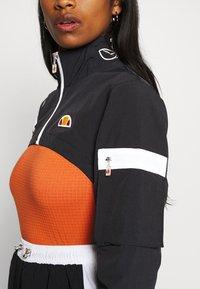 Ellesse - LAUDE CROP TRACK  - Summer jacket - black - 5