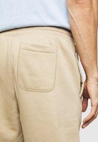 GAP - ARCH  - Tracksuit bottoms - beige - 5
