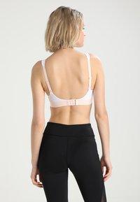 triaction by Triumph - HYBRID LITE - High support sports bra - white - 2