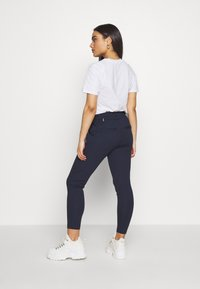 ONLY Petite - ONLPOPTRASH EASY NEW SPORTY TAPE PETIT - Trousers - night sky - 2