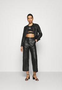 Calvin Klein Jeans - PRIDE MILANO - Top - black - 1