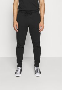 Calvin Klein Jeans - LOGO PANT - Pantaloni sportivi - black - 0