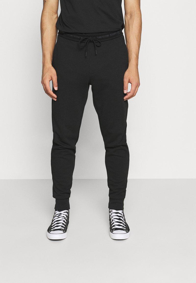 Calvin Klein Jeans - LOGO PANT - Pantaloni sportivi - black