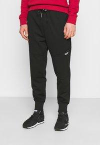 Calvin Klein Jeans - SUSTAINABLE MILANO PANT - Verryttelyhousut - black - 0