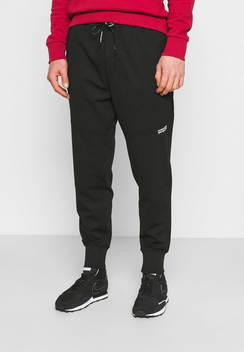 Calvin Klein Jeans - SUSTAINABLE MILANO PANT - Verryttelyhousut - black