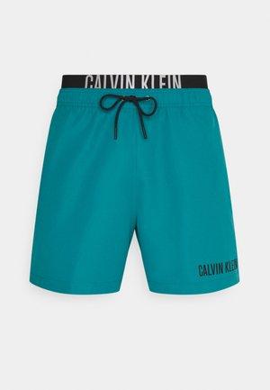 INTENSE POWER MEDIUM DOUBLE - Swimming shorts - green