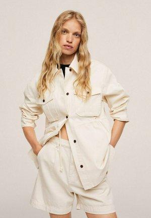 SAHARIENNE - Short coat - écru