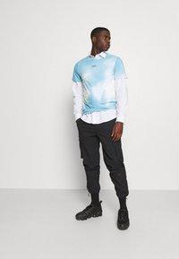 Hollister Co. - CREW WASH - Print T-shirt - greenish blue - 1