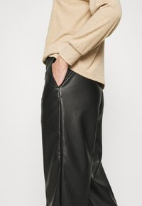 Vila - VIPEN CROPPED COATED PANTS  - Trousers - black - 5