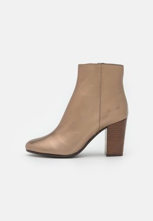 ABELLE - Classic ankle boots - bronze