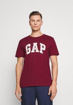 LOGO ARCH - T-shirt z nadrukiem - red delicious