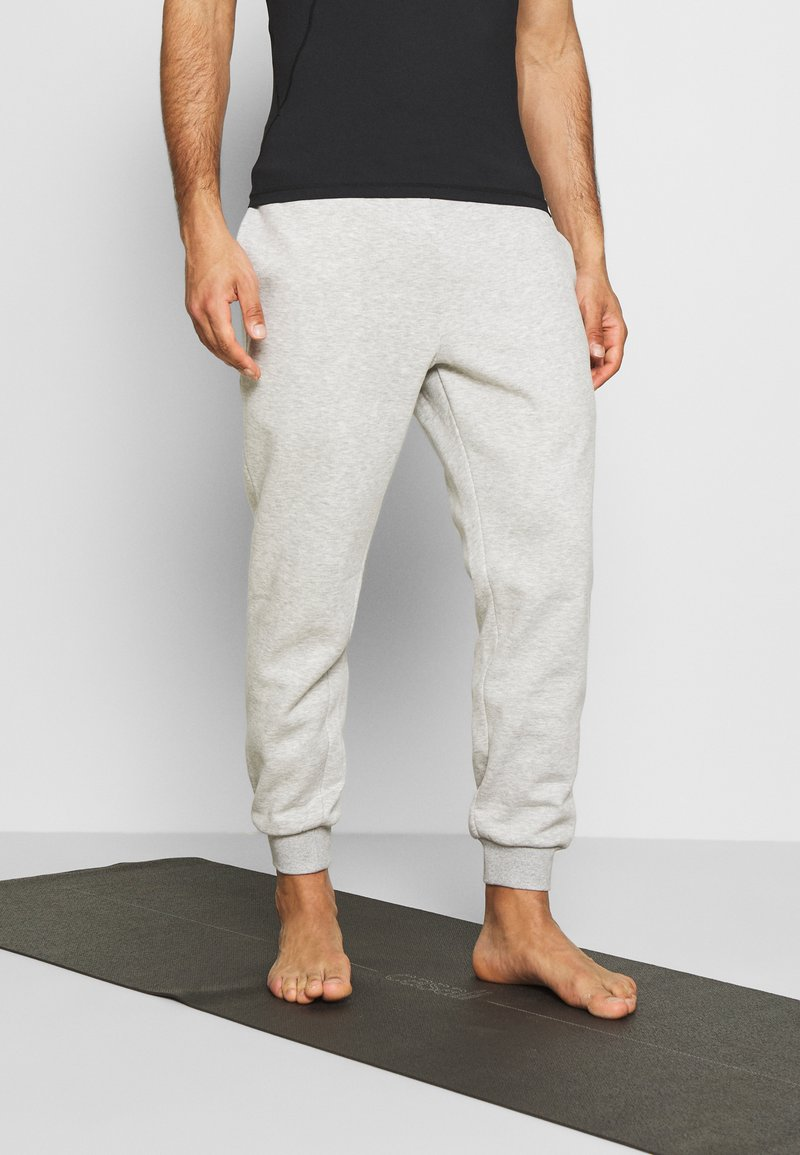 Curare Yogawear - LONG PANTS - Tracksuit bottoms - lightgrey melange