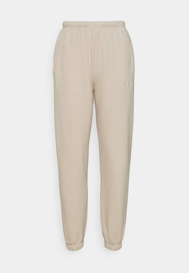 FAITH PANTS - Teplákové kalhoty - stone beige
