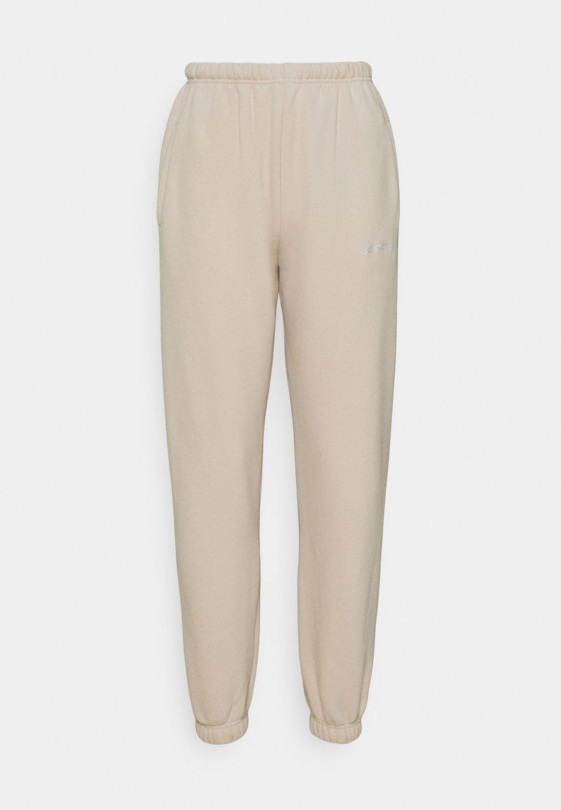 WRSTBHVR - FAITH PANTS - Teplákové kalhoty - stone beige