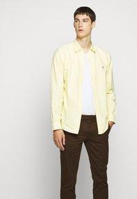 Polo Ralph Lauren - STRETCH SLIM FIT COTTON CHINO - Pantalon classique - mohican brown - 4