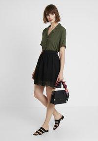 Vero Moda - VMAISHA SHORT SKIRT - A-line skirt - black - 1