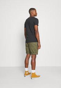 Marc O'Polo - SHORT SLEEVE CREW NECK ARTWORK ON CHEST - Print T-shirt - black - 2